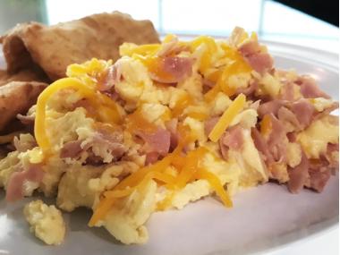 Scrambled eggs with cheese and ham